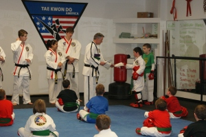 Receiving his award certificate and new belt.