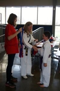 Receiving his bronze medal.