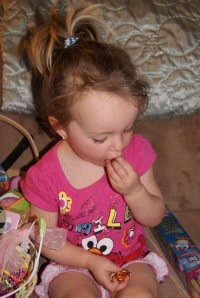 Lily wasted no time digging into her favorite treat... pumpkin Hershey Kisses.
