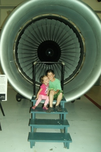 Posing in front of a CF 6 Turbofan Engine.