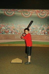 Rydan holding Joey Votto's bat.