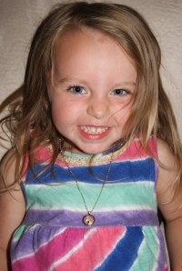 Showing off her new horse necklace from Nana & Pappy.