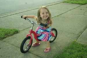and her big surprise... her very own pink Kazam balance bike!