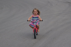 She'd been borrowing our neighbor's blue Kazam all summer long, she's quite a pro at this bike already.  We're all amazed how fast she learned to balance.  No training wheels for this lady!