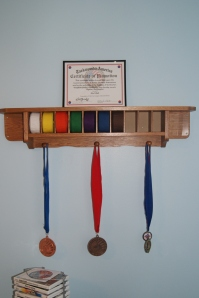Rydan is finally able to display his Taekwondo belts and medals.