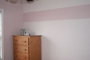 "Lily's pretty pink and white painted room, thanks to ""Papoose."""