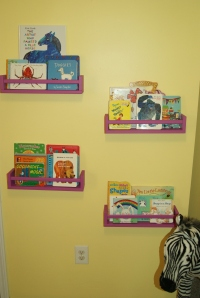 These are our Ikea spice rack bookshelves.  With a little paint, these work great for displaying Lily's favorite board books.