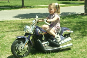Taking a spin on Rydan's old Harley.  Hard to believe this thing still runs, but Lily loves it.