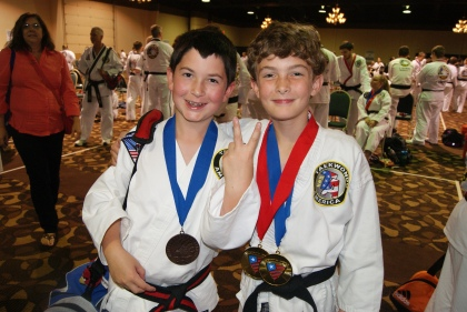 Here he is with his friend, Hunter, showing off their medals.